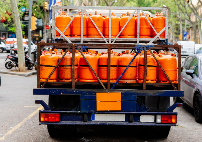 Gas delivery. Truck with orange propane gas tanks
